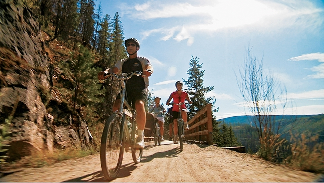 Cyclists biking the Kettle Valley Rail Trail